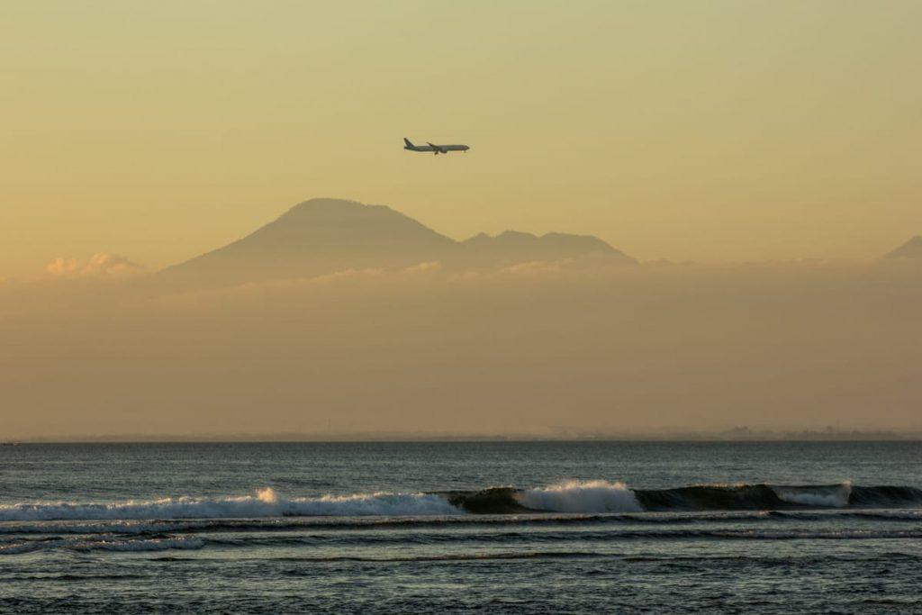 Bali volcano plane Padang Padang beach